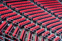Indoor arena seats. Rows of seats inside the large indoor venue Royalty Free Stock Photos
