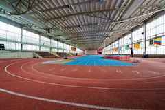 Indoor athletics arena at stadium Royalty Free Stock Image