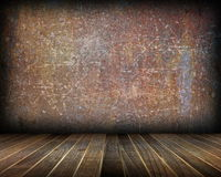 Indoor backdrop with distressed rusty wall Royalty Free Stock Images