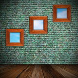 Indoor backdrop with frames on wall Royalty Free Stock Images