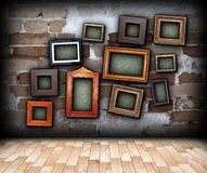 Indoor backdrop with painting frames hung on wall Royalty Free Stock Photos