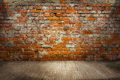 Indoor background with red brick wall an wooden plank floor Royalty Free Stock Photos