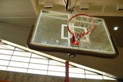 Indoor basketball hoop. Indoor basketbool hoop with a grungy looking wall as a backdrop Stock Photos