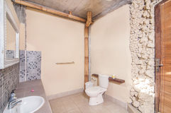 Indoor Batroom. Luxury bathroom indoor location with outdoor view and stone wall Stock Photos