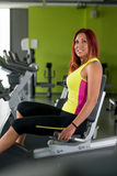 Indoor bicycle cycling in gym. Young Women spinning in the gym, exercising her legs doing cardio training Stock Image