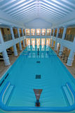 Indoor big blue swimming pool Stock Images