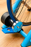 Indoor bike trainer. Detail of professional indoor bike trainer. Rear wheel with magnetic resistance rotor Royalty Free Stock Photos