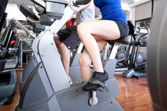 Indoor biking. Group of people training in a gym Stock Photography