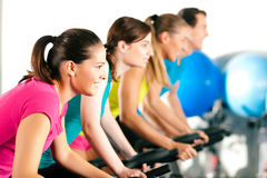 Indoor bycicle cycling in gym Stock Image