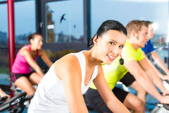 Indoor bycicle cycling in gym stock images