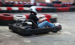 Indoor carting. Race (cart and safety barriers Stock Images