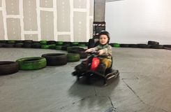 Indoor carting boy motion blur Royalty Free Stock Photos