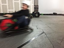 Indoor carting girl motion blur Royalty Free Stock Photography