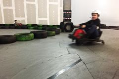 Indoor carting girl motion blur Stock Image