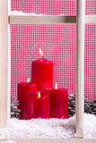 Indoor Christmas window sill decoration:  four red candles,snow Royalty Free Stock Photography