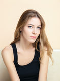 Indoor closeup portrait of young beautiful fashionable woman in black t-shirt Royalty Free Stock Photos