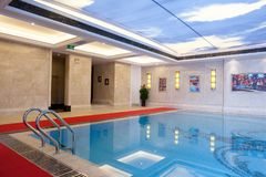 Indoor constant-temperature swimming pool. In hotel Royalty Free Stock Photo