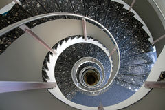 Indoor dark mosaic spiral staircase Royalty Free Stock Image