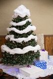 Christmas Tree Wedding Decor. Indoor decor at a wedding reception featuring this Christmas tree where guests can leave presents during a winter wedding in Oregon Royalty Free Stock Photography