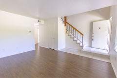 Indoor entry room in condo with wood floors Stock Photos