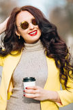 Indoor fashion spring portrait of elegant sexy woman in luxury bright glamour outfit,red lips, trendy yellow jacket and Royalty Free Stock Photo