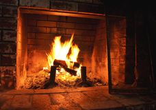 Indoor Fireplace with cozy fire Stock Photo