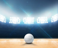 Indoor Floodlit Volleyball Court. A 3D rendering of an indoor volleyball court and ball on a wooden floor under illuminated floodlights stock illustration