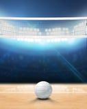 Indoor Floodlit Volleyball Court. A 3D rendering of an indoor volleyball court with a net and ball on a wooden floor under illuminated floodlights Stock Photo