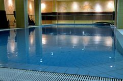 Indoor freshwater pool with dolphin designs Stock Photo