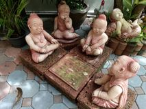 Many clay dolls of Thailand in garden decoration Royalty Free Stock Photography