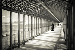 Indoor glass tunnel for pedestrians. Stock Photo