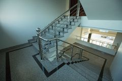 Indoor granite Staircase With stainless steel Handrail. In the hotel stock images
