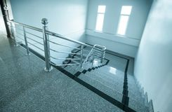 Indoor granite Staircase With stainless steel Handrail. In the hotel stock photo