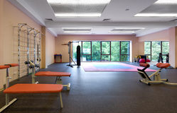 Indoor gym. In a fitness club Stock Photos