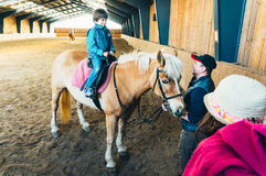 Indoor horse riding lessons Royalty Free Stock Photography