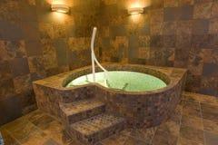 Indoor jacuzzi pool. With warm interior decor Stock Photos