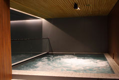 Indoor jacuzzi pool with boiling water at the spa center Royalty Free Stock Images