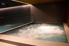 Indoor jacuzzi pool with boiling water at the spa center Stock Photos