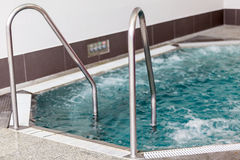 Indoor jacuzzi. View with stairs guardrails Royalty Free Stock Photos