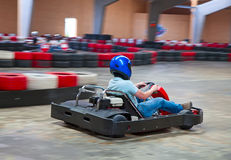 Indoor karting. Race (kart and safety barriers Stock Photography