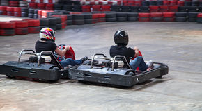 Indoor karting. Race (2 kart and safety barriers Royalty Free Stock Photos