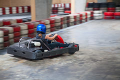 Indoor karting. Race (kart and safety barriers Stock Photos