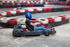 Indoor karting. Race (kart and safety barriers Royalty Free Stock Image