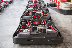 Indoor karting. Race (karts and safety barriers Stock Photo