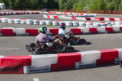 Indoor karting race. Rushing kart and safety barriers Royalty Free Stock Photos