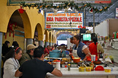 Indoor Market Food Stall. People enjoying the food at Tepotzotlan market, Mexico, on a fiesta day stock images