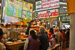 Indoor Market Food Stall. People enjoying the food at Tepotzotlan market, Mexico, on a fiesta day (1th of January stock image