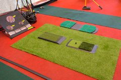 Indoor mini golf and holes for practicing inside building royalty free stock image