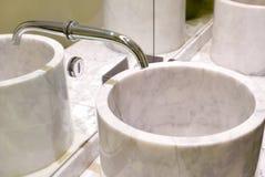 Indoor modern water sink with mirror reflection in restroom Stock Photos