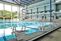 Indoor olympic size swimming pool. A modern architecture of an indoor olympic sized swimming pool Royalty Free Stock Photography